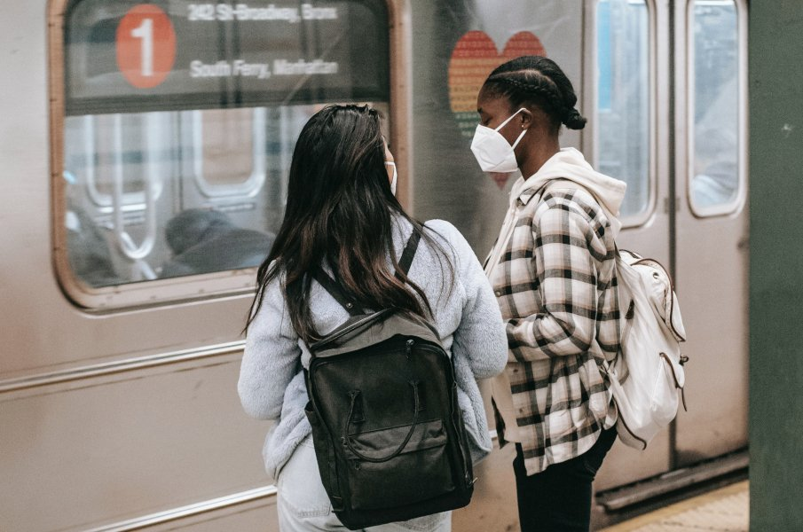 two students making a transfer in a subway station
