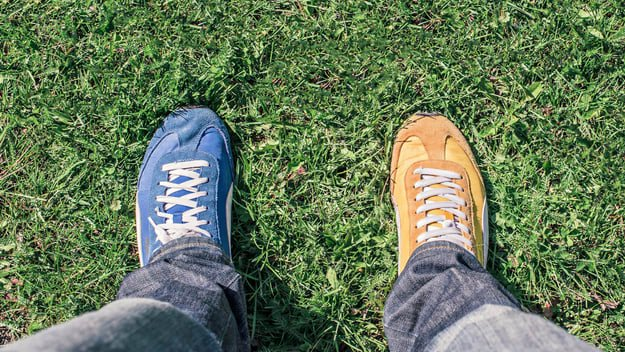man wearing shoes with different colors