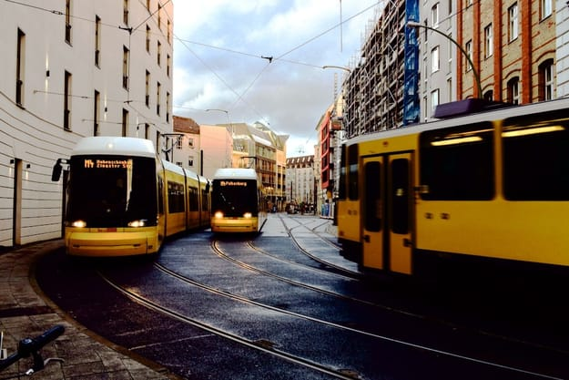 3 yellow trams in the city of Berlin, capital of Germany