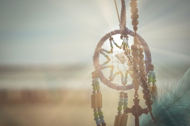 a dream catcher with sun lights shining through it