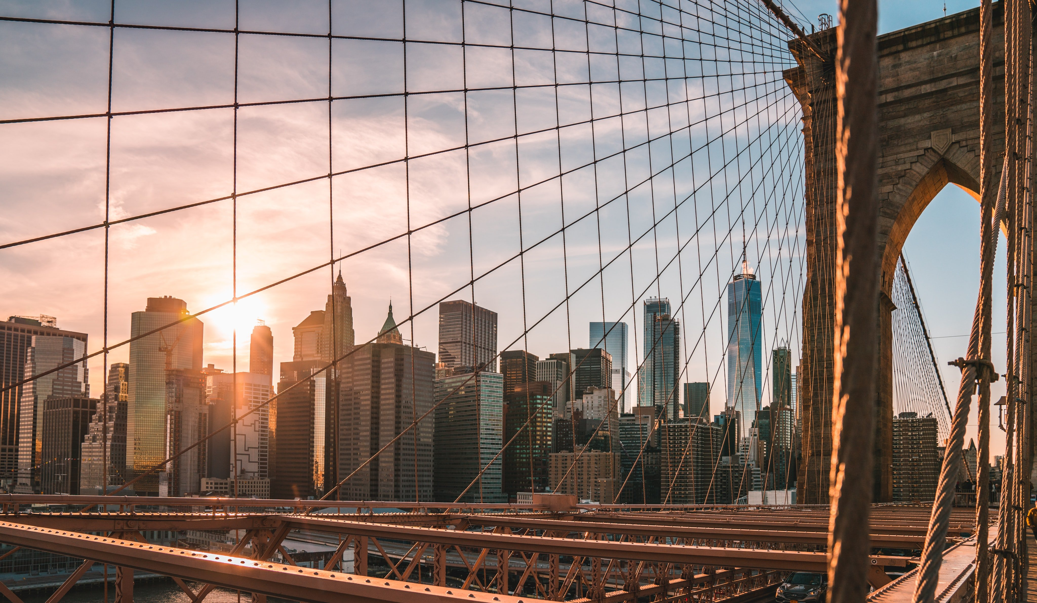 The skyline of New York as seen from the Brooklyn Bridge