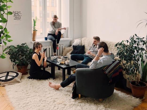 people having breakfast in the living room very happy