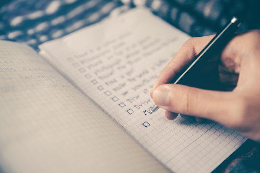 person making a checklist