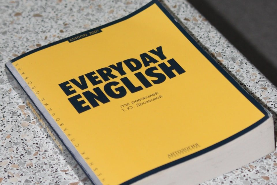"""book with a yellow cover with the words """"everyday english"""""""